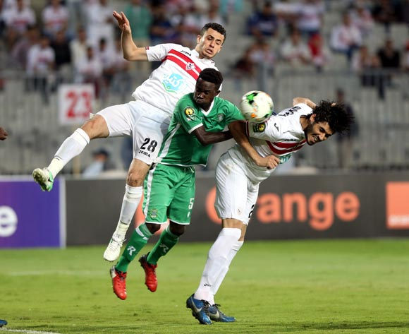 Al-Zamalek player Ali Gaber (L) Mahmoud Hamdy in action against Caps United player HardlifeZvirekw  (C) during the African Champions League (CAF) Round of 16 match between Al-Zamalek and Caps United at at Borg Al Arab Stadium in Alexandria , Egypt, 12 May 2017