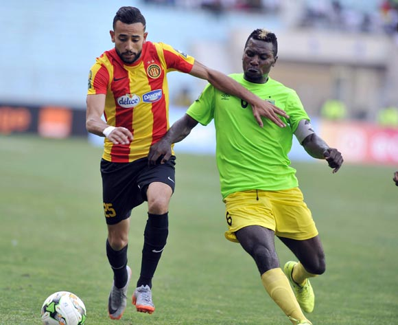 Chalali Chilane (L) of Esperance Tunis vies for the ball with Omba Munganga (R) AS Vita Club during the CAF Champions League match between Esperance Tunis and AS Vita Club in Tunis, Tunisia, 12 May 2017