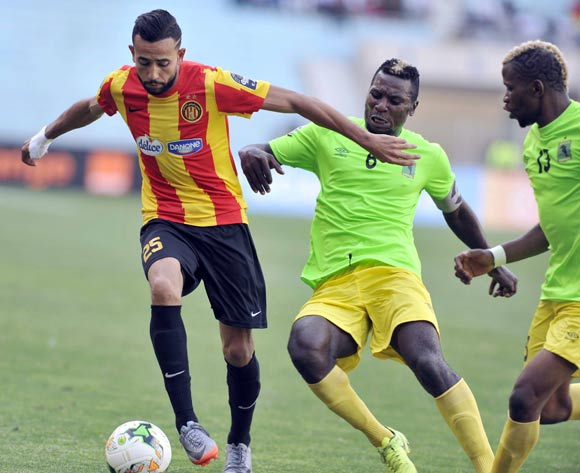 Chalali Chilane (L) of Esperance Tunis vies for the ball with Omba Munganga (C) AS Vita Club during the CAF Champions League match between Esperance Tunis and AS Vita Club in Tunis, Tunisia, 12 May 2017