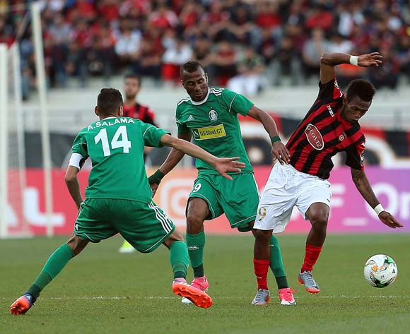 Andriamahitsinoro Charles Carlous (R) of USM Alger vies for the ball with Aleyat Mohamed (C) and Ramadan Salama Aliof Al Ahly Tripoli during the CAF Champions League match between USM Alger and Al Ahly Tripoli in Algiers, Algeria, 12 May 2017