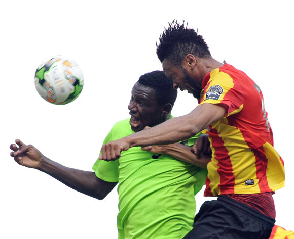 Coulibaly Fousseny (R) of Esperance Tunis vies for the ball with Ondo Francisco (L) AS Vita Club during the CAF Champions League match between Esperance Tunis and AS Vita Club in Tunis, Tunisia, 12 May 2017