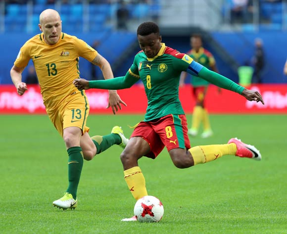 Benjamin Moukandjo of Cameroon (C) and Aaron Mooy of Australia (L) in action during the FIFA Confederations Cup 2017 group B soccer match between Cameroon and Australia at the Saint Petersburg stadium in St.Petersburg, Russia, 22 June 2017.  EPA/SRDJAN SUKI