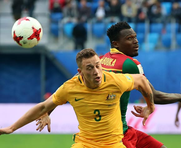 epa06043710 Ernest Mabouka of Cameroon (R) and Alex Gersbach of Australia (L) in action during the FIFA Confederations Cup 2017 group B soccer match between Cameroon and Australia at the Saint Petersburg stadium in St.Petersburg, Russia, 22 June 2017.  EPA/SRDJAN SUKI