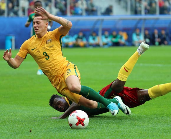epa06043764 Ernest Mabouka of Cameroon (L) fouls Alex Gersbach of Australia during the FIFA Confederations Cup 2017 group B soccer match between Cameroon and Australia at the Saint Petersburg stadium in St.Petersburg, Russia, 22 June 2017.  EPA/SRDJAN SUKI