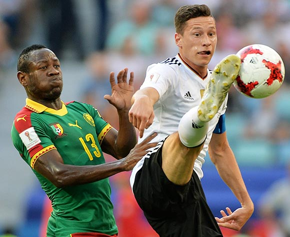 epa06049764 Julian Draxler (R) of Germany in action against Christian Bassogog of Cameroon during the FIFA Confederations Cup 2017 group B soccer match between Germany and Cameroon at the Fisht Stadium in Sochi, Russia, 25 June 2017.  EPA/PETER POWELL