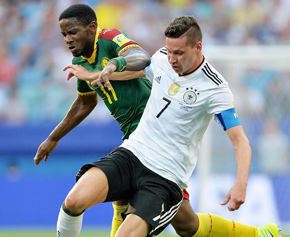 epa06049823 Julian Draxler (R) of Germany in action against Arnaud Djoum of Camerron during the FIFA Confederations Cup 2017 group B soccer match between Germany and Cameroon at the Fisht Stadium in Sochi, Russia, 25 June 2017.  EPA/PETER POWELL