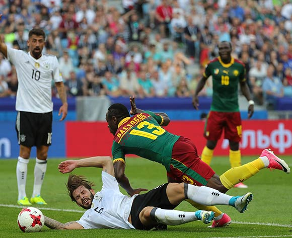 epa06049836 Marvin Plattenhardt (down) of Germany and Christian Bassogog of Cameroon in action  during the FIFA Confederations Cup 2017 group B soccer match between Germany and Cameroon at the Fisht Stadium in Sochi, Russia, 25 June 2017.  EPA/ARMANDO BABANI