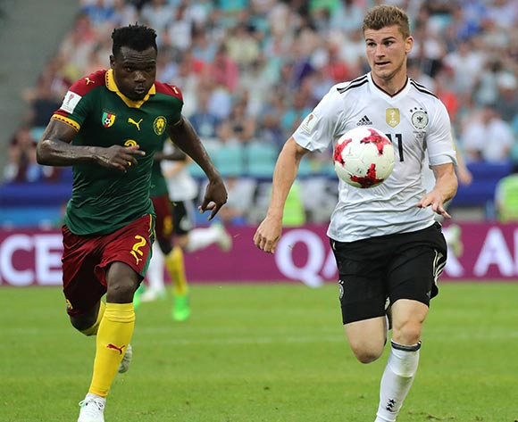 epa06049956 Ernest Mabouka (L) of Cameroon and Timo Werner of Germany in action during the FIFA Confederations Cup 2017 group B soccer match between Germany and Cameroon at the Fisht Stadium in Sochi, Russia, 25 June 2017.  EPA/ARMANDO BABANI