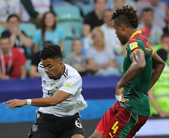 epa06050041 Adolphe Teikeu (R) of Cameroon and Benjamin Henrichs of Germany in action during the FIFA Confederations Cup 2017 group B soccer match between Germany and Cameroon at the Fisht Stadium in Sochi, Russia, 25 June 2017.  EPA/ARMANDO BABANI