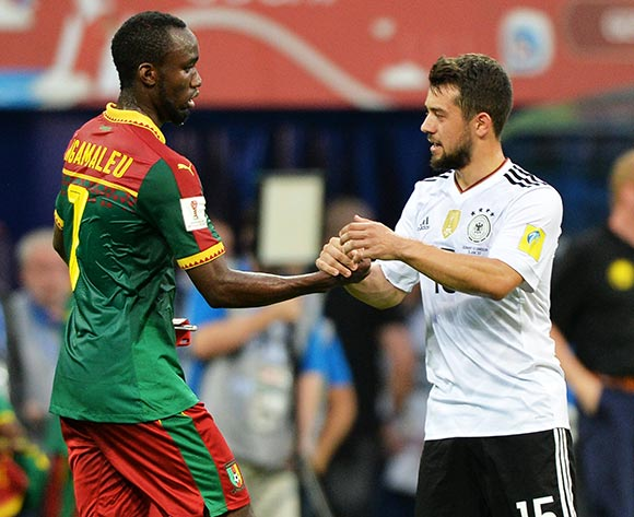 epa06050180 Nicolas Ngamaleu (L) of Cameroon shakes hands with Amin Younes of Germany after the FIFA Confederations Cup 2017 group B soccer match between Germany and Cameroon at the Fisht Stadium in Sochi, Russia, 25 June 2017.  EPA/PETER POWELL