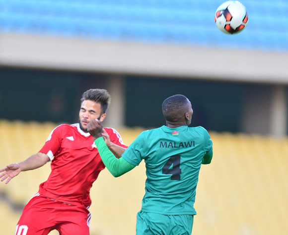 Chembezi Denis of Malawi challenged by Jeremy Villeneuve of Mauritius during the Cosafa Castle Cup match between Malawi and Mauritius at the Royal Bafokeng Stadium in Rustenburg on 27 June 2017 ©Samuel Shivambu/BackpagePix
