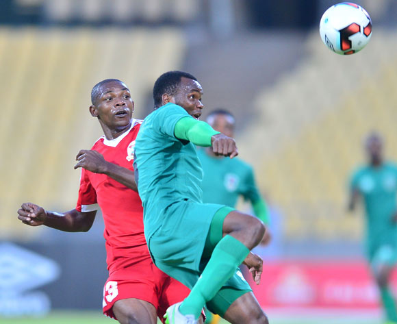 John Lanjesi of Malawi challenged by Joseph Edouard of Mauritius during the Cosafa Castle Cup match between Malawi and Mauritius at the Royal Bafokeng Stadium in Rustenburg on 27 June 2017 ©Samuel Shivambu/BackpagePix
