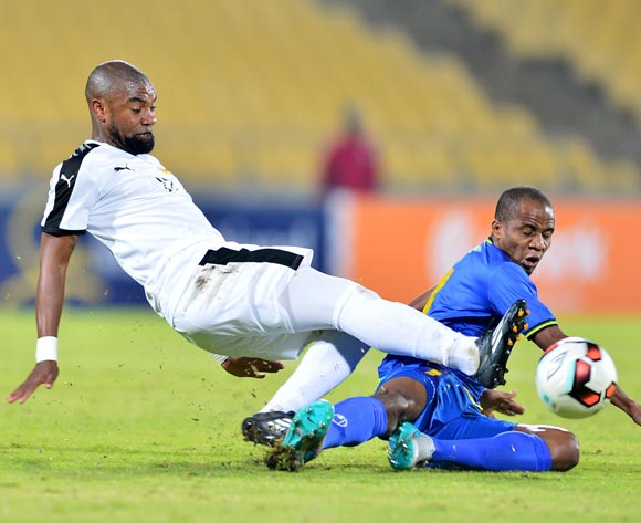 Himid Mkami of Tanzania challenged by Eduardo Da Cruz Leite of Angola during the Cosafa Castle Cup match between Angola and Tanzania at the Royal Bafokeng Stadium in Rustenburg on 27 June 2017 ©Samuel Shivambu/BackpagePix