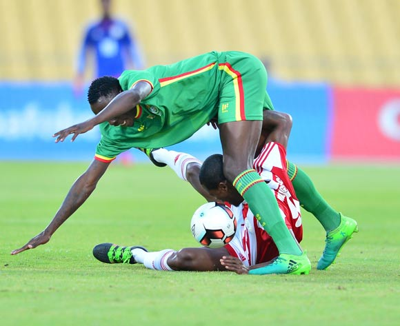 Sarivahy Vombola of Madagascar challenged by Liberty Chakoroma of Zimbabwe during the Cosafa Castle Cup match between Zimbabwe and Madagascar at the Royal Bafokeng Stadium in Rustenburg on 28 June 2017 ©Samuel Shivambu/BackpagePix