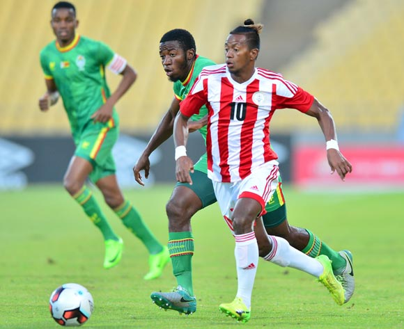 Andriamirado Andrianarimanana of Madagascar challenged John Takwara of Zimbabwe during the Cosafa Castle Cup match between Zimbabwe and Madagascar at the Royal Bafokeng Stadium in Rustenburg on 28 June 2017 ©Samuel Shivambu/BackpagePix