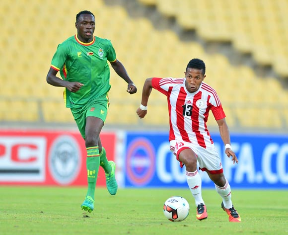 Rinjala Raherinaivo of Madagascar challenged by Liberty Chakoroma of Zimbabwe during the Cosafa Castle Cup match between Zimbabwe and Madagascar at the Royal Bafokeng Stadium in Rustenburg on 28 June 2017 ©Samuel Shivambu/BackpagePix