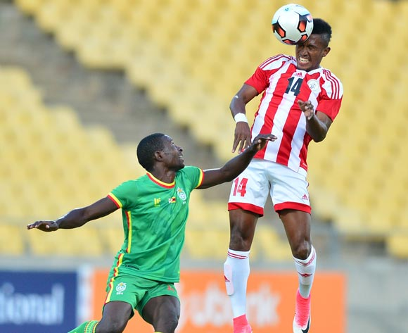 Jean Claude Marobe of Madagascar challenged by Blessing Majarira of Zimbabwe during the Cosafa Castle Cup match between Zimbabwe and Madagascar at the Royal Bafokeng Stadium in Rustenburg on 28 June 2017 ©Samuel Shivambu/BackpagePix