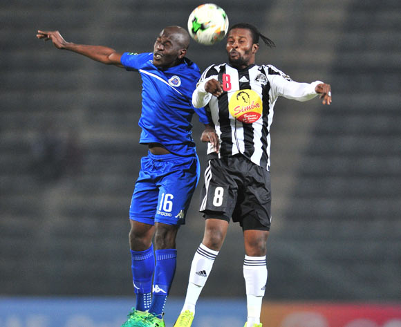 Tresor Mputu Mabi of TP Mazembe challenged by Aubrey Modiba of Supersport United during the Caf Confederation Cup match between Supersport United and TP Mazembe at the Lucas Moripe Stadium in Pretoria on 20 June 2017 ©Samuel Shivambu/BackpagePix