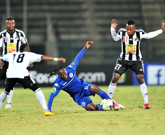 Reneilwe Letsholonyane of Supersport United challenged by Michee Mika and Rainford Kalaba of TP Mazembe during the Caf Confederation Cup match between Supersport United and TP Mazembe at the Lucas Moripe Stadium in Pretoria on 20 June 2017 ©Samuel Shivambu/BackpagePix