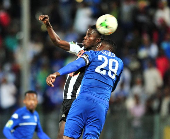 Ben Ngita of TP Mazembe challenged by Morgan Gould of Supersport United during the Caf Confederation Cup match between Supersport United and TP Mazembe at the Lucas Moripe Stadium in Pretoria on 20 June 2017 ©Samuel Shivambu/BackpagePix