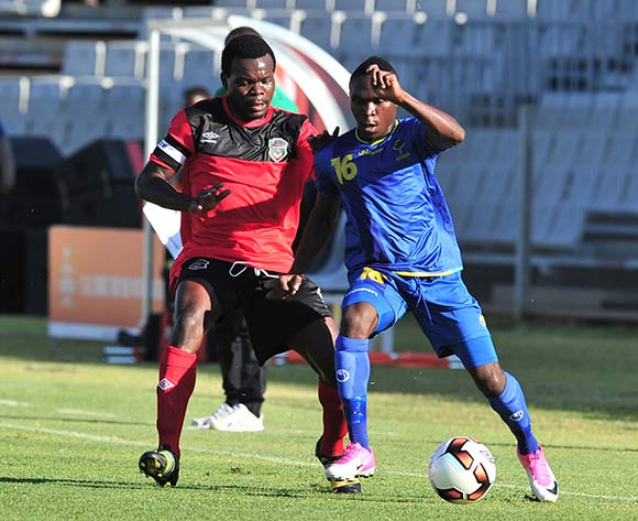 Yahya Raamadhani of Tanzania challenged by Francis Mulimba of Malawi during the Cosafa Castle Cup match between Tanzania and Malawi at the Moruleng Stadium in Rustenburg on 25 June 2017 ©Samuel Shivambu/BackpagePix