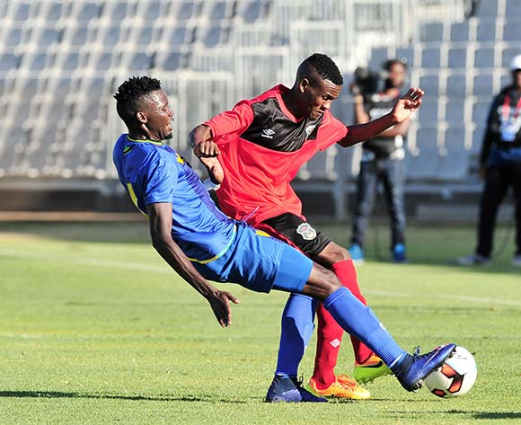 Dalitso Sailesi of Malawi tackled by Erasto Nyoni of Tanzania during the Cosafa Castle Cup match between Tanzania and Malawi at the Moruleng Stadium in Rustenburg on 25 June 2017 ©Samuel Shivambu/BackpagePix