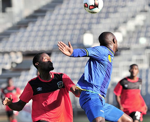 Salim Mbonde of Tanzania challenged by Jabulani Linje of Malawi during the Cosafa Castle Cup match between Tanzania and Malawi at the Moruleng Stadium in Rustenburg on 25 June 2017 ©Samuel Shivambu/BackpagePix