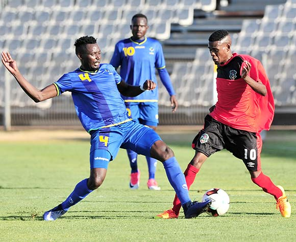 Dalitso Sailesi of Malawi challenged by Erasto Nyoni of Tanzania during the Cosafa Castle Cup match between Tanzania and Malawi at the Moruleng Stadium in Rustenburg on 25 June 2017 ©Samuel Shivambu/BackpagePix