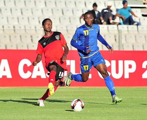 Simeon Singa of Malawi challenged by Mbaraka Abed of Tanzania during the Cosafa Castle Cup match between Tanzania and Malawi at the Moruleng Stadium in Rustenburg on 25 June 2017 ©Samuel Shivambu/BackpagePix