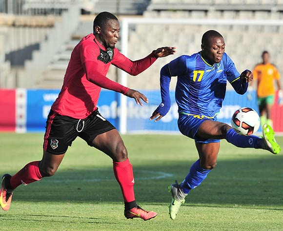 Mbaraka Abed of Tanzania challenged by Lucky Malata of Malawi during the Cosafa Castle Cup match between Tanzania and Malawi at the Moruleng Stadium in Rustenburg on 25 June 2017 ©Samuel Shivambu/BackpagePix