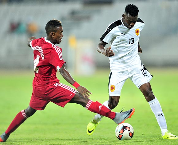 Afonso Cabungula of Angola challenged by Francis Rasolofonirina of Mauritius during the Cosafa Castle Cup match between Mauritius and Angola at the Moruleng Stadium in Rustenburg on 25 June 2017 ©Samuel Shivambu/BackpagePix
