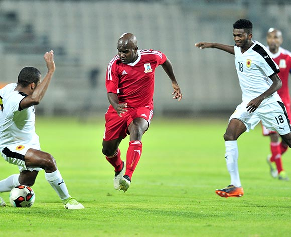 Herbert Nany (c) of Mauritius challenged by Carlos Carmo (l) of Angola challenged  during the Cosafa Castle Cup match between Mauritius and Angola at the Moruleng Stadium in Rustenburg on 25 June 2017 ©Samuel Shivambu/BackpagePix