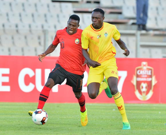 Nelson Divrassone of Mozambique challenged by Liberty Chakoroma of Zimbabwe during the Cosafa Castle Cup match between Mozambique and Zimbabwe at the Moruleng Stadium in Rustenburg on 26 June 2017 ©Samuel Shivambu/BackpagePix