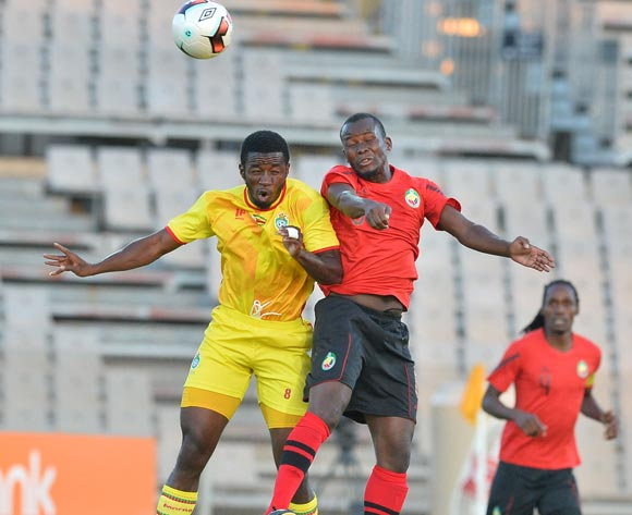 John Takwara of Zimbabwe challenged by Abilio Moucuona of Mozambique during the Cosafa Castle Cup match between Mozambique and Zimbabwe at the Moruleng Stadium in Rustenburg on 26 June 2017 ©Samuel Shivambu/BackpagePix