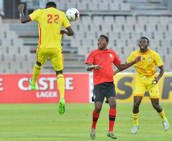 Liberty Chakoroma of Zimbabwe challenged by Mamo Saide of Mozambique during the Cosafa Castle Cup match between Mozambique and Zimbabwe at the Moruleng Stadium in Rustenburg on 26 June 2017 ©Samuel Shivambu/BackpagePix