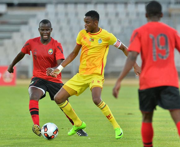 Ovidy Karuru of Zimbabwe challenged by Abilio Moucuona of Mozambique during the Cosafa Castle Cup match between Mozambique and Zimbabwe at the Moruleng Stadium in Rustenburg on 26 June 2017 ©Samuel Shivambu/BackpagePix
