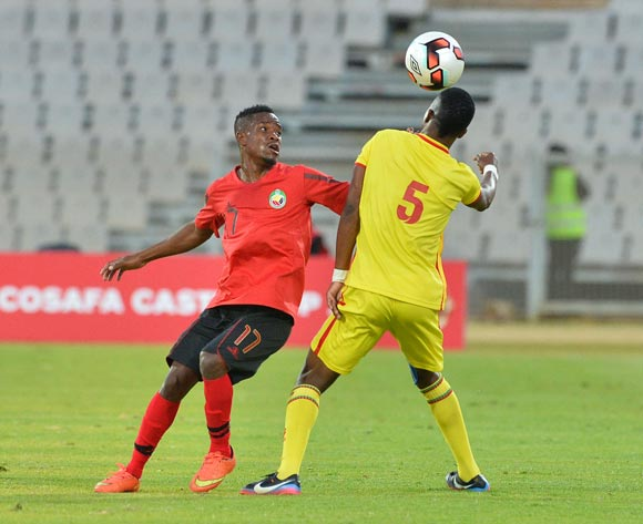 Jameson Mukombwe of Zimbabwe challenged by Shelton Dava of Mozambique during the Cosafa Castle Cup match between Mozambique and Zimbabwe at the Moruleng Stadium in Rustenburg on 26 June 2017 ©Samuel Shivambu/BackpagePix