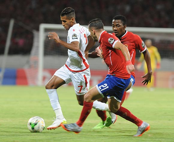 Wydad Athletic Club Mohamed Ounajem (L) fights for the ball with Al Ahly Sporting Club Oluwafemi Ajayi (R)and Ali Maaloul (C) during the 2017 CAF Champions League game between Wydad Athletic Club  and Al Ahly Sporting Club at Stade Mohamed V in Casablanca, Morocco on 20 June 2017 © BackpagePix