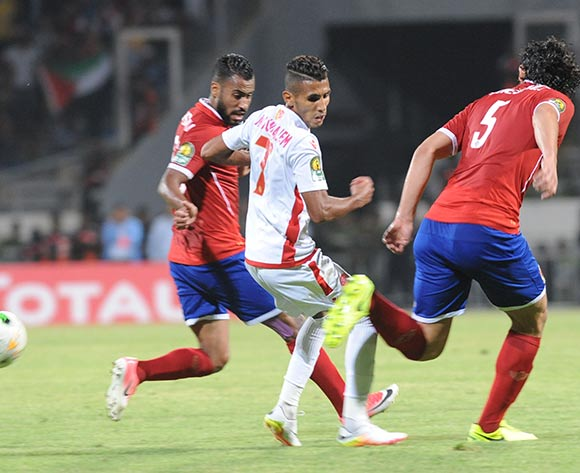 Wydad Athletic Club Mohammed Ounajem (C) fights for the ball with Al Ahly Sporting Ahmed Elsayed (R) and Hossam Ashour (L) during the 2017 CAF Champions League game between Wydad Athletic Club and Al Ahly Sporting Club at Stade Mohamed V in Casablanca, Morocco on 20 June 2017 © BackpagePix