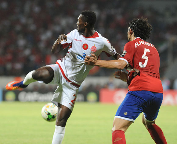 Wydad Athletic Club Fabrice Ondama  (L) fights for the ball with Al Ahly Sporting Club Ahmed Esayed Hegazy (R) during the 2017 CAF Champions League game between Wydad Athletic Club and Al Ahly Sporting Club at Stade Mohamed V in Casablanca, Morocco on 20 June 2017 © BackpagePix