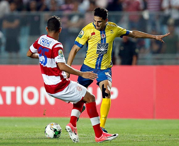 Club Africain player Walid Dhaouadi  (L) fights for the ball with FATH Union Sport player  Mohamed Nahiri (R) during the 2017 CAF Confederations Cup game between Club Africain and FATH Union Sport at Stade Olympique Rades in Tunis, Tunisia on 20 June 2017 © BackpagePix