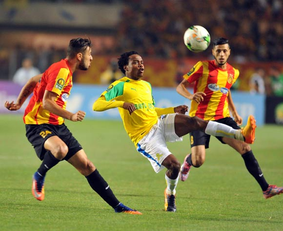 Mamelodi Sundowns player Percy Tau (C) fights for the ball with  Esperance players during the 2017 CAF Champions League game between Esperance and Mamelodi Sundowns at Stade Olympique In Tunis, Tunisia on 21 June 2017 © BackpagePix