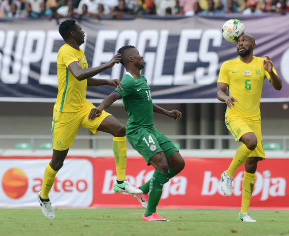 Kelechi Iheanacho of Nigeria (c) and Ramahlwe Mphahlele (r)  and Erick Mathoho of South Africa (l)  during the 2019 Afcon football qualifier between Nigeria and South Africa at Godswill Akpabio International Stadium on June 10, 2017 in Uyo State, Nigeria. @Kabiru Abubakar/BackpagePix