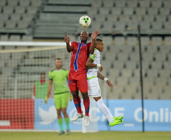 Sabelo Wilson Ndzinisa of Mbabane Swallows and Vuyo Mere of Platinum Stars during the CAF Confederation Cup match between Platinum Stars and Mbabane Swallows on the 08 July 2017 at Moruleng Stadium  © Sydney Mahlangu /BackpagePix