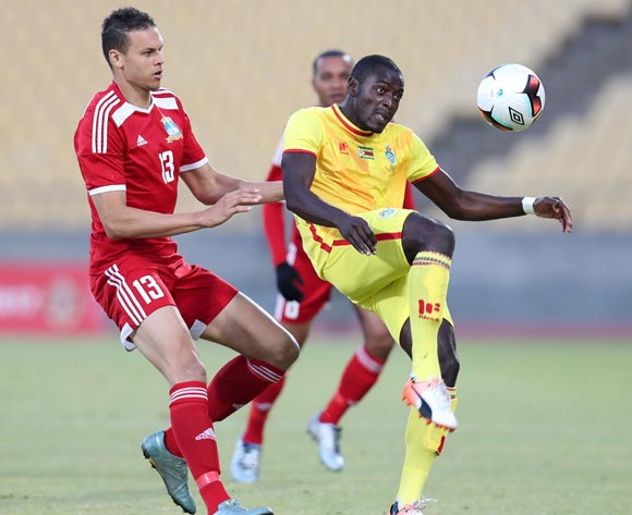 Eric Chipeta of Zimbabwe clears ball from Karl Hall of Seychelles during the 2017 Cosafa Castle Cup match between Zimbabwe and Seychelles at the Royal Bafokeng Stadium, Rustenburg South Africa on 30 June 2017 ©Muzi Ntombela/BackpagePix