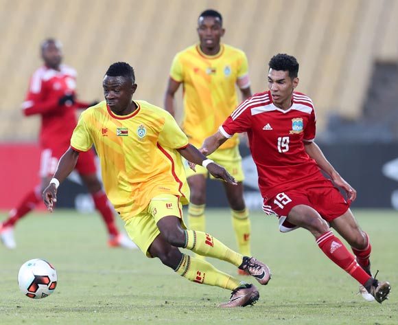 Innocent Mucheneka of Zimbabwe challenged by Carl Hopprich of Seychelles during the 2017 Cosafa Castle Cup match between Zimbabwe and Seychelles at the Royal Bafokeng Stadium, Rustenburg South Africa on 30 June 2017 ©Muzi Ntombela/BackpagePix
