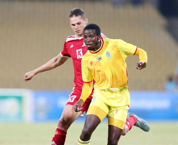John Takwara of Zimbabwe challenged by Karl Hall of Seychelles during the 2017 Cosafa Castle Cup match between Zimbabwe and Seychelles at the Royal Bafokeng Stadium, Rustenburg South Africa on 30 June 2017 ©Muzi Ntombela/BackpagePix