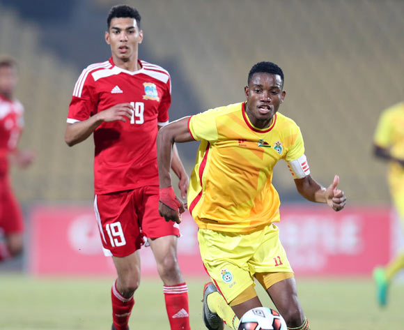 Ovidy Karuru of Zimbabwe challenged by Carl Hopprich of Seychelles during the 2017 Cosafa Castle Cup match between Zimbabwe and Seychelles at the Royal Bafokeng Stadium, Rustenburg South Africa on 30 June 2017 ©Muzi Ntombela/BackpagePix
