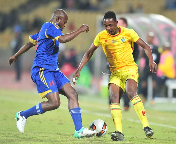 Machawe Dlamini of Swaziland challenged by Dude Prince of Zimbabwe during 2017 Cosafa Castle Cup match between Swaziland and Zimbabwe at Royal Bafokeng Stadium in Rustenburg on 02 July 2017 ©Samuel Shivambu/BackpagePix