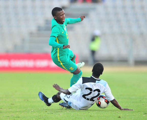 Ndunduzo Sibiya of South Africa tackled by Thabo Leinanyane of Botswana during 2017 Cosafa Castle Cup match between Botswana and South Africa at Moruleng Stadium in Rustenburg on 04 July 2017 ©Samuel Shivambu/BackpagePix